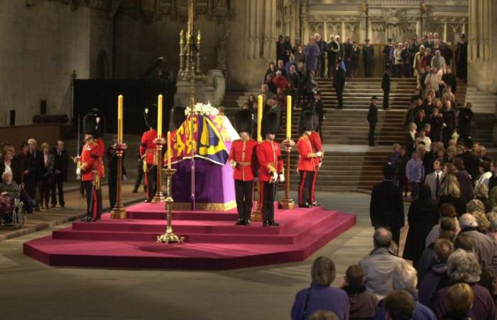Guards surrounding coffin